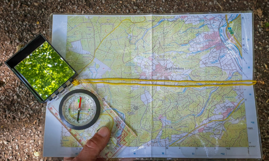 Orientation with compass and hiking map
